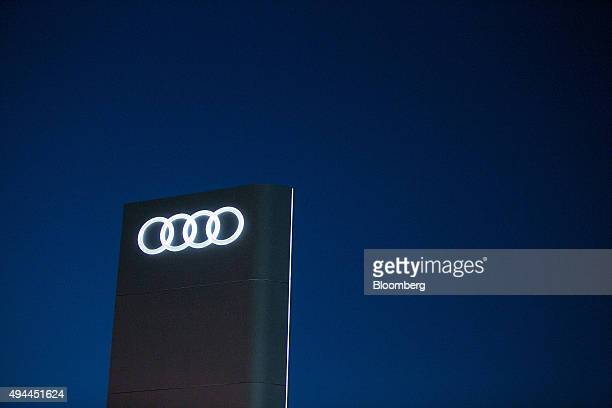 The Audi rings logo sits on a sign outside the Audi Forum at the Audi AG headquarters in Ingolstadt Germany on Monday Oct 26 2015 The towns that...