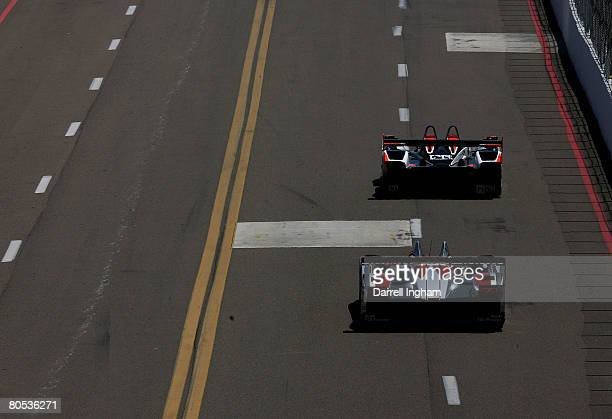 The Audi Sport North America Audi R10 driven by Frank Biela chases the Intersport Racing Lola B06 during the American Le Mans Series Acura Sports Car...