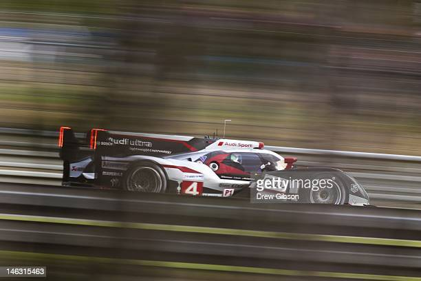 The Audi Sport North America Audi R18 Ultra driven by Oliver Jarvis of England Marco Bonanomi of Italy and Mike Rockenfeller of Germany during...
