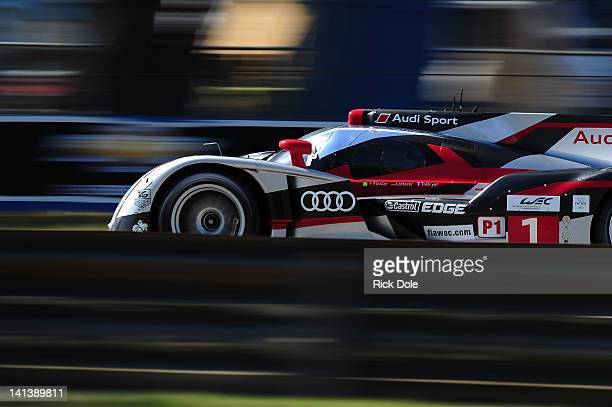 The Audi Sport Team Joest Audi R18 driven by Andre Lotterer of Germany, Benoit Treluyer of France, and Marcel Fassler of Switzerland, during practice...