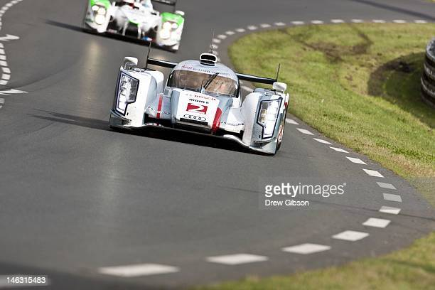 The Audi Sport Team Joest Audi R18 etron quattro hybrid driven by Allan McNish of Scotland Tom Kristensen of Denmark Dindo Capello of Italy during...