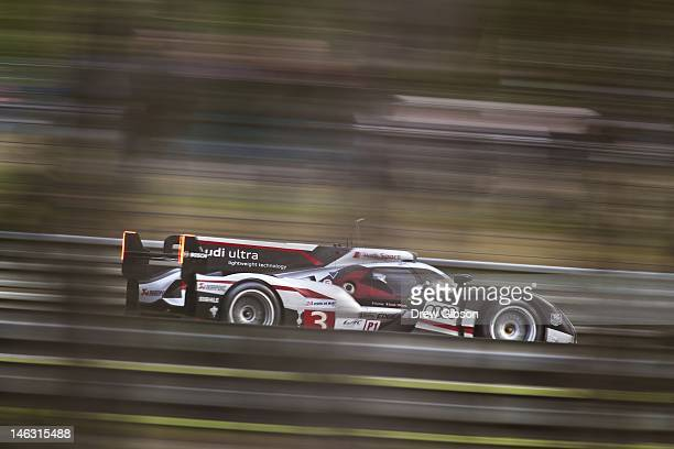The Audi Sport Team Joest Audi R18 Ultra driven by Marc Gene of Spain Romain Dumas of France and Loic Duval of France during practice for the 80th...