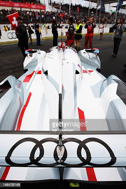 The Audi Sport Team Joest R18 ETron Quattro of Andre Lotterer Marcel Fassler and Benoit Treluyer sits at the head of the grid before the start of the...