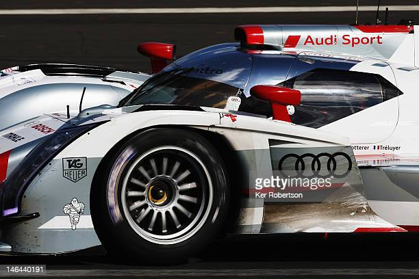 The Audi Sport Team Joest R18 ETron Quattro of Andre Lotterer Marcel Fassler and Benoit Treluyer drives during the Le Mans 24 Hour race at the...