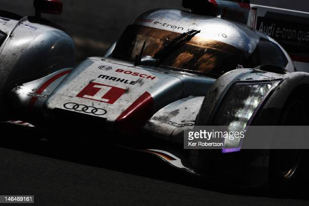 The Audi Sport Team Joest R18 ETron Quattro of Andre Lotterer Marcel Fassler and Benoit Treluyer drives on its way to winning the Le Mans 24 Hour...