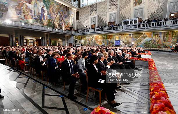 The audience applauds Myanmar democracy icon Aung San Suu Kyi on June 16 2012 at the Oslo City Hall as she delivers her Nobel Peace Prize speech 21...