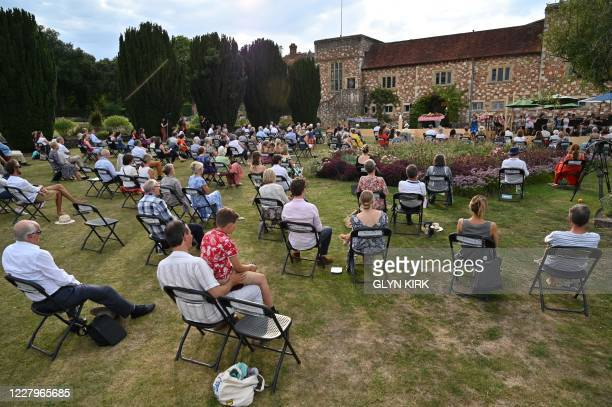 The audience are spread across the garden as performers take part in a preview of a socially-distanced opera, a translation of Jacques Offenbachs...