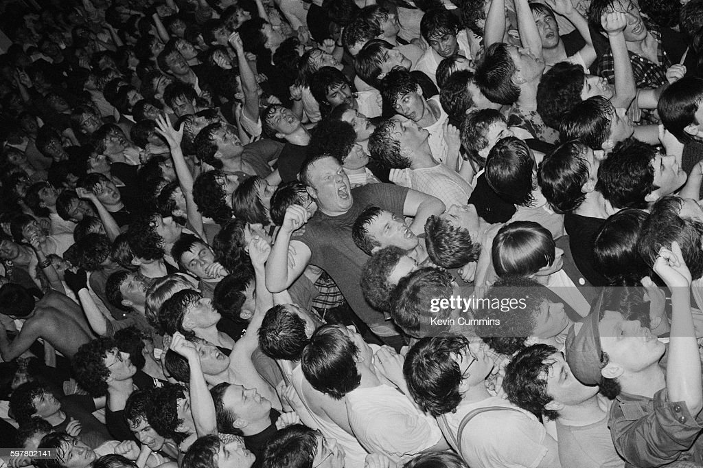 The audience at a concert by Irish rock group U2 at Leeds University