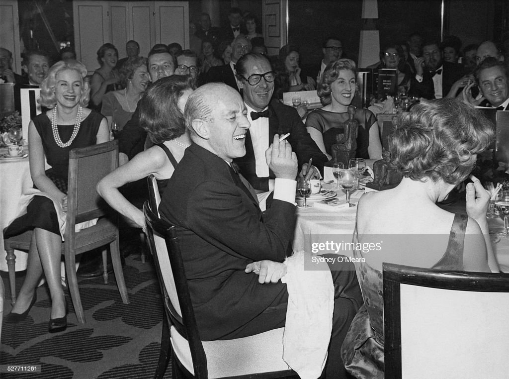 The audience at the Evening Standard theatre awards during a performance by comedian Frankie Howerd, London, 24th January 1961. Among the audience are Scottish actress Mary Ure (1933 - 1975, far left), English actors Alec Guinness (1914 - 2000, foreground) and Rex Harrison (1908 - 1990, centre, right) and Jacqueline Hylton (centre, right), daughter of impresario Jack Hylton.