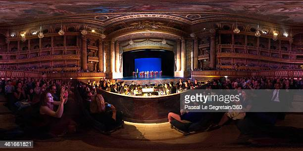 The audience awaits the dancers on stage as the orchestra prepares to play during Tercentenary Gala at the Royal Opera on April 25 2013 in Versailles...