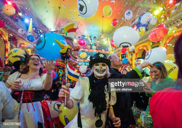 The audience celebrates at the sesssion finale during the general rehearsal for the Carnival television special 'Mainz bleibt Mainz wie es singt und...
