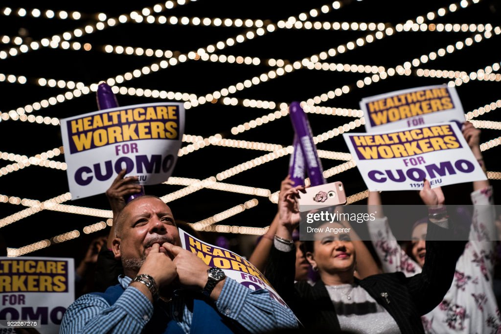 The audience cheers for New York Governor Andrew Cuomo as he speaks at a healthcare union rally at the Theater at Madison Square Garden, February 21, 2018 in New York City. The rally was organized by 1199SEIU United Healthcare Workers East, the largest healthcare union in the United States.