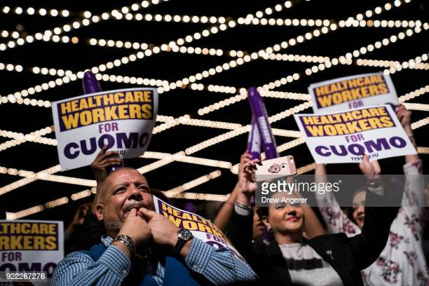 The audience cheers for New York Governor Andrew Cuomo as he speaks at a healthcare union rally at the Theater at Madison Square Garden February 21...