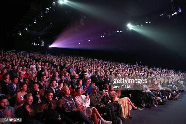 """The audience during the European Premiere of """"Widows"""" and opening night gala of the 62nd BFI London Film Festival at Embankment Garden Cinema on..."""
