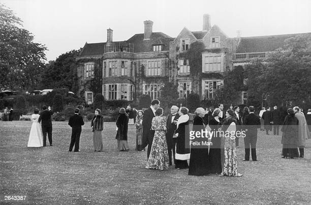 The audience enjoy an interval in the gardens of Glyndebourne Opera House Sussex Original Publication Picture Post 164 Glyndebourne pub 1939