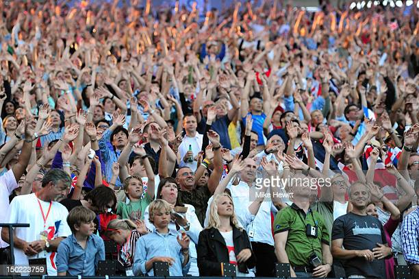 The audience enjoys the Closing Ceremony on Day 16 of the London 2012 Olympic Games at Olympic Stadium on August 12 2012 in London England