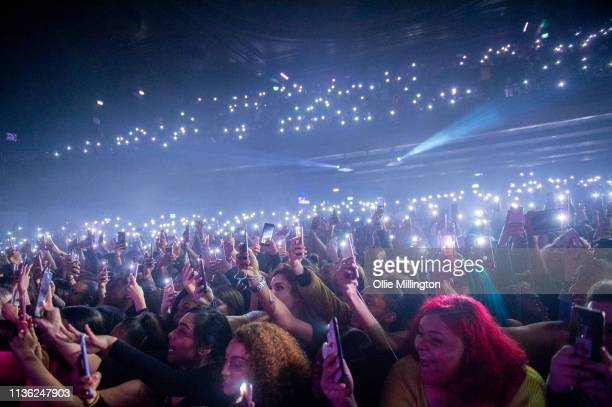 The audience hold up mibile phone lights as Jacquees performs on stage at o2 Forum Kentish Town on April 10 2019 in London England