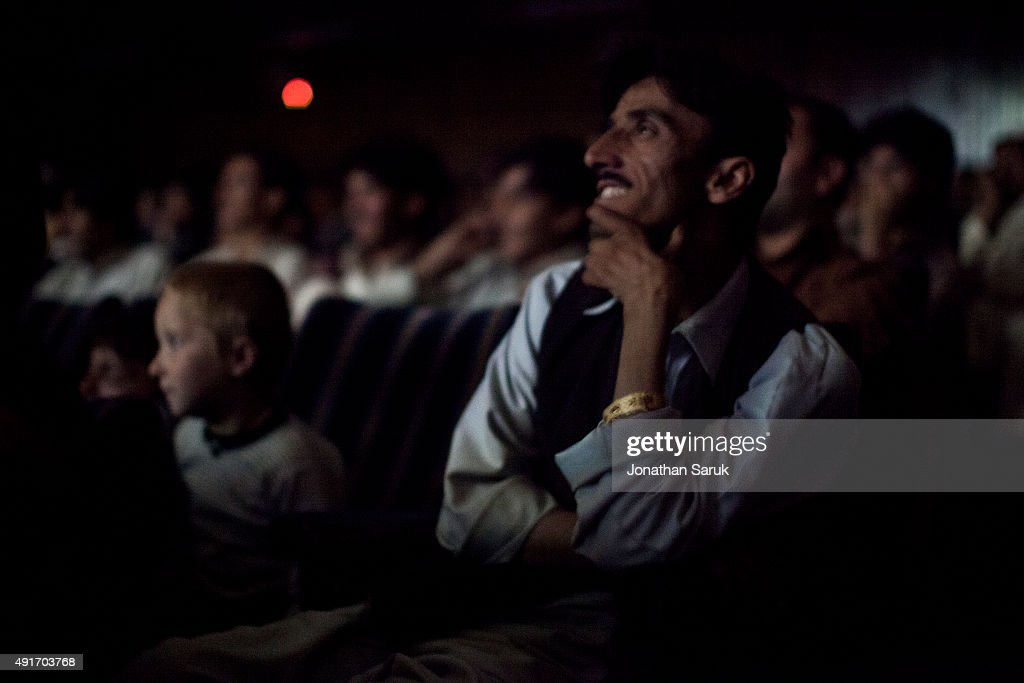 The audience in Pamir Cinema during a showing of a Pakistani film June 2, 2011 in Kabul, Afghanistan. Going to the movies, once banned under the Taliban, has become a popular form of entertainment in Kabul, but women and children rarely take part.