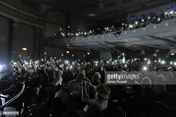 The audience light up thier cell phones after Cuban muscian Carlos Varela's performance at The Poet Of Havana screening during the 2015 Woodstock...