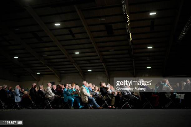 The audience listen as Leader of the Brexit Party Nigel Farage addresses party members and delegates at the Westpoint Centre on September 22 2019 in...