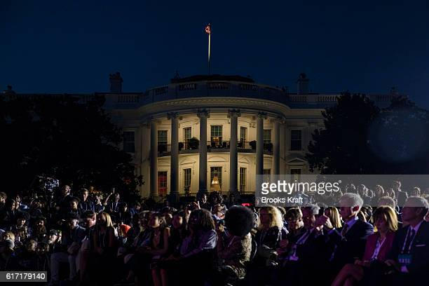 The audience listens as US President Barack Obama atmospheric scientist Katharine Hayhoe and actor Leonardo DiCaprio participate in a conversation...