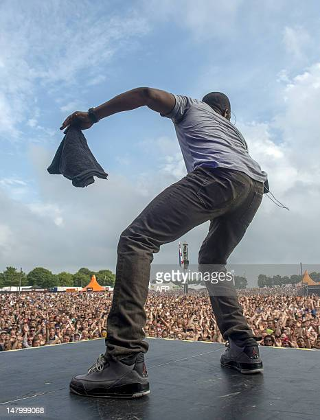 The audience listens to the American hip hop band The Roots performance on July 7 20102 at the Roskilde Festival in Roskilde AFP PHOTO / SCANPIX /...