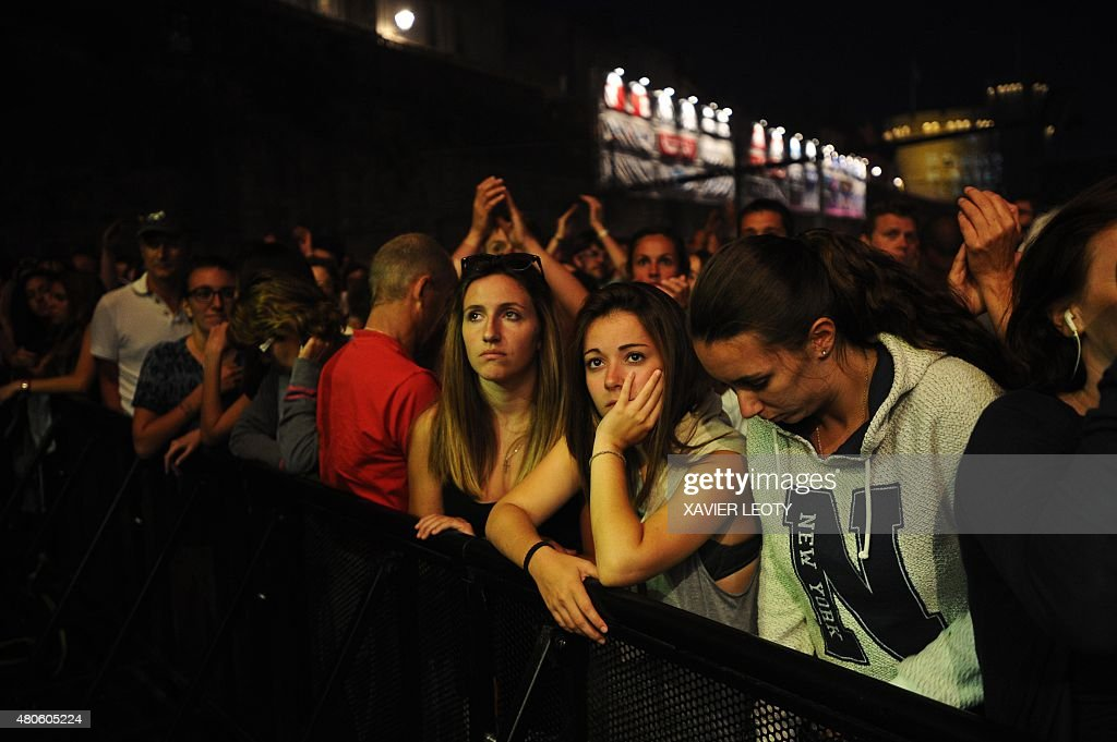 The audience looks on during the concert of French musician Arthur H. at the Francofolies Music Festival in La Rochelle on July 13, 2015.