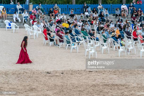 The audience maintains social distance during the performance of Electra by theatre company Noite Bohemia on the beach of San Amaro on July 04 2020...