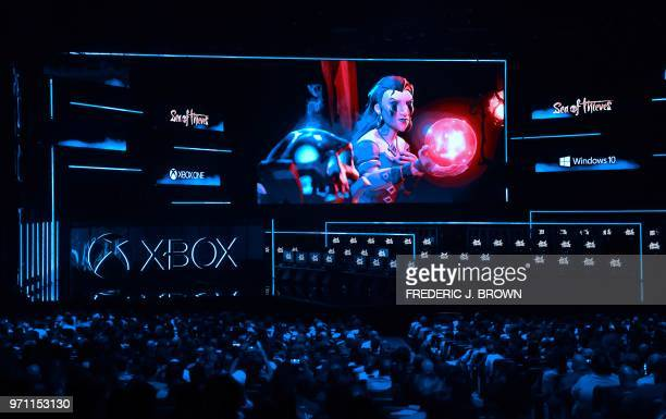 The audience previews of scenes from the game 'Sea of Thieves' at the Xbox 2018 E3 briefing in Los Angeles California on June 10 2018 ahead of the...