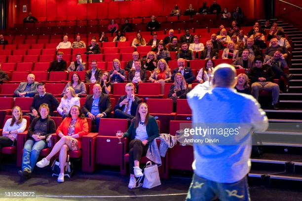 The audience react as a comedian performs during a comedy test event at ACC Liverpool on April 28, 2021 in Liverpool, England. This is a one-off...