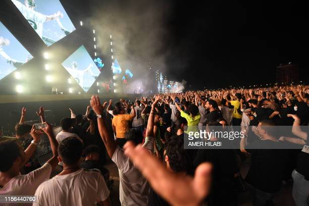 The audience reacts during US singer Janet Jackson's performance during the Jeddah World music Festival late on July 18 at the King Abdullah Sports...
