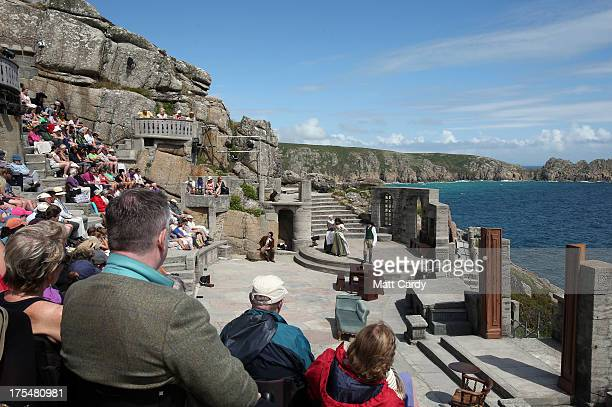 The audience take their seats as they watch Wuthering Heights presented by Ilkley Playhouse at the Minack Theatre on August 2 2013 in Porthcurno near...