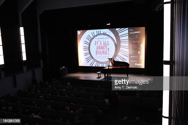 The audience takes their seats before pianist Imogen Cooper performs an all Schubert program at a Steinway grand piano on stage in Cine Lumiere...