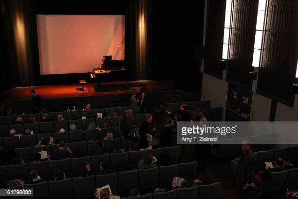 The audience takes their seats before Pianist Nick van Bloss performs at a Steinway grand piano on stage in Cine Lumiere during 'It's All About...