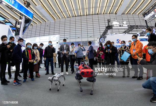 """The audience visit the performance of the electronic dog with automatic inspection at the Internet Conference """"Internet light"""" Expo. Wuzhen, Jiaxing..."""