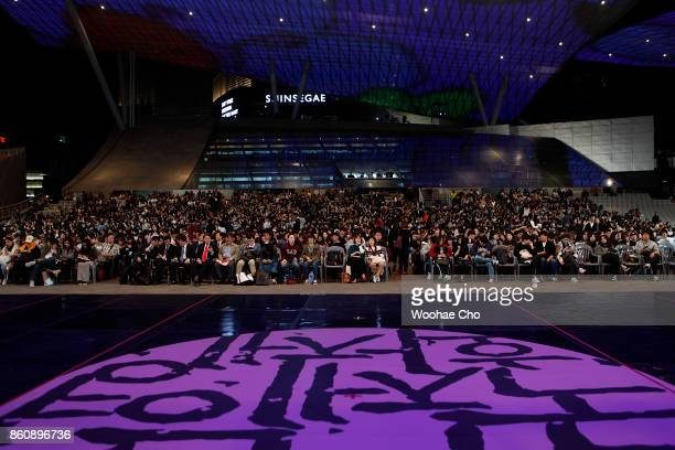 The audience wait the director Darren Aronofsky before the official screening of 'mother' during the Busan International Film Festival on October 13...