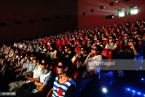 The Audience watch the 3D film 'Transformers Age Of Extinction' through 3D glasses at a cinema on June 27 2014 in Wuhan Hubei Province of China