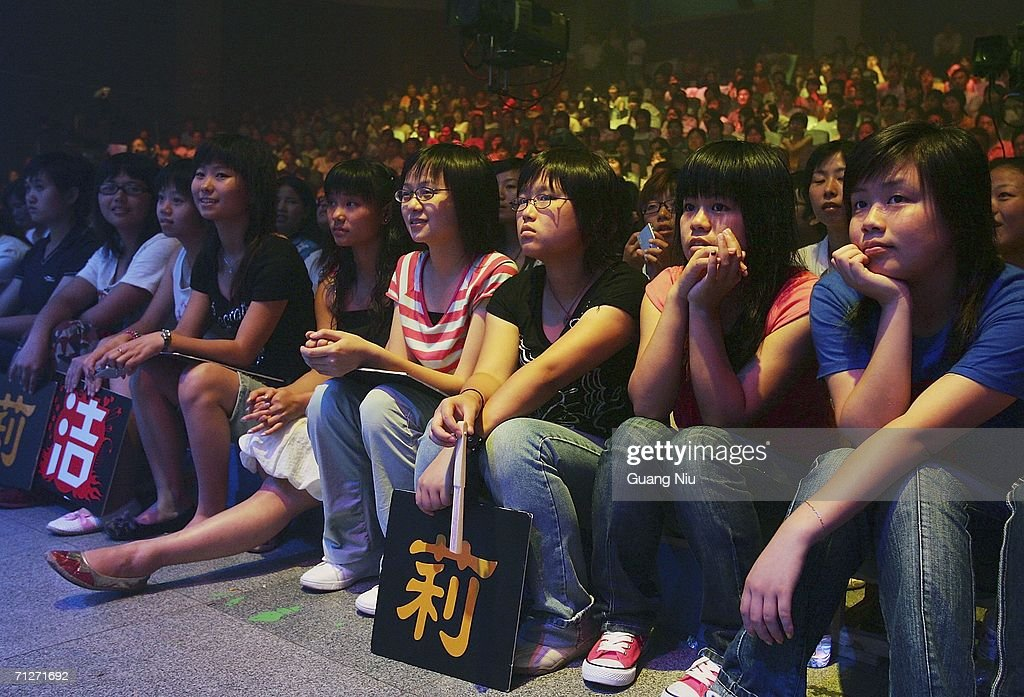 The audience watch TV show 'Super Girl Voice' as it's recorded at Hunan Satellite TV station on June 21, 2006 in Changsha city, Hunan province of China. 'Super Girl Voice' is an entertainment program/talent show produced to select new girl stars. More and more Chinese youth are entering TV entertainment shows in an attempt to become famous and new pop idols.
