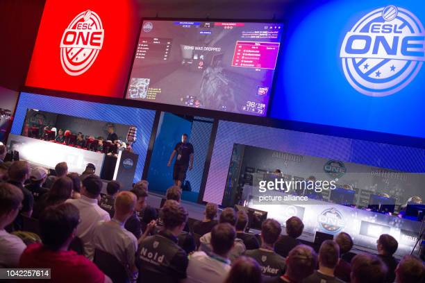 The audience watches a tournament of the e-sports league ESL, at the Gamescom gaming convention in Cologne, Germany, 7 August 2015. The ESLis...