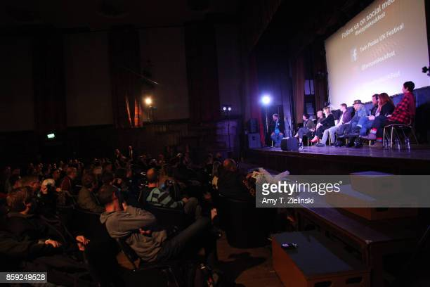 The audience watches as Author Tom Huddleston of Time Out magazine in London interviews actors Sherilyn Fenn James Marshall Amy Shiels Jake Wardle...