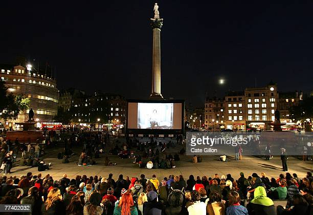 The audience watches as pianist Neil Brand provides the accompaniment to archive films being shown on the big screen in Trafalgar Square on October...