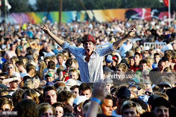 The audience watches Danish metal band Volbeat perform on July 2 2009 at the Roskilde Festival in Denmark AFP PHOTO / SCANPIX DENMARK