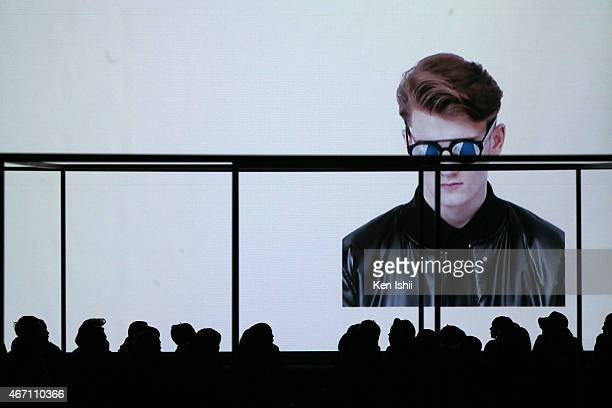 The audience watches presentation on a screen during the JOHN LAWRENCE SULLIVAN show as part of Mercedes Benz Fashion Week TOKYO 2015 A/W at Shibuya...