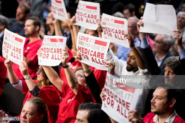 The audience waves signs as Sen Bernie Sanders IVt speaks during his event to introduce the Medicare for All Act of 2017 on Wednesday Sept 13 2017
