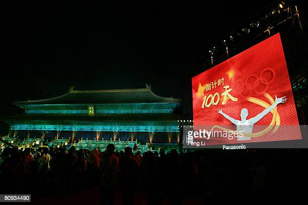 The audiences watch the performance during the Award-giving Ceremony for the 4th Olympic Songs Competition at the lighted Worker People's Cultural...