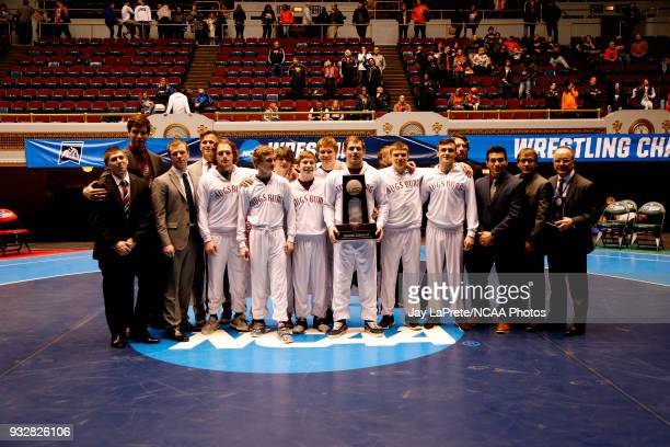The Augsburg wrestling team stands with their National Runners Up trophy at the close of the Division III Men's Wrestling Championship held at the...