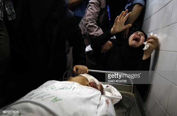 The aunt of Yasser Abu alNaja a Palestinian youth in his early teens who was killed in border clashes near Khan Yunis reacts at a hospital morgue in...