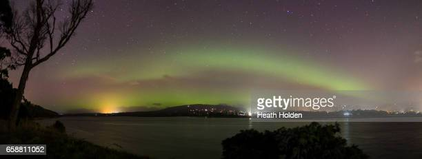 "Image is a digital [panoramic] composite.) The Aurora Australis, or ""Southern Lights"" light up over the Mersey River in Devonport on March 27, 2017..."