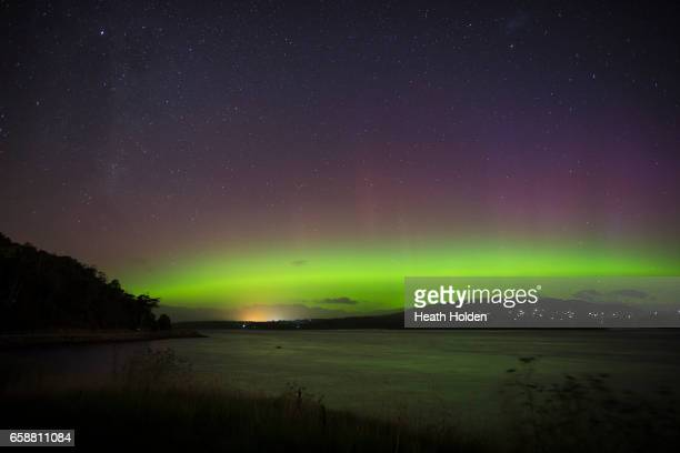 "The Aurora Australis, or ""Southern Lights"" light up over the Mersey River in Devonport on March 27, 2017 in Devonport, Australia. Aurora Australis,..."