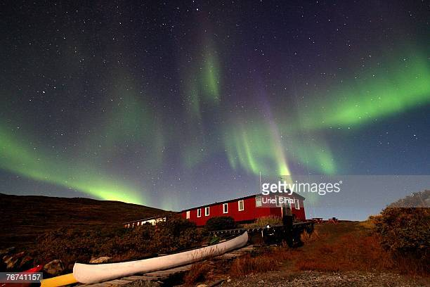 The Aurora Borealis glows over a hut near the town of Kangerlussuaq September 02 in the Greenland town of Kangerlussuaq The Northern Lights most...